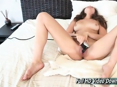 bailey uses the vintage sex tool on the bed for