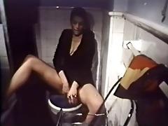 lady choking snake on water closet