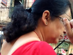 hot aunty with large love bubbles in market