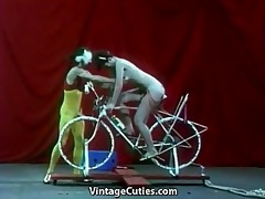 pretty cutie is riding a sex-bike